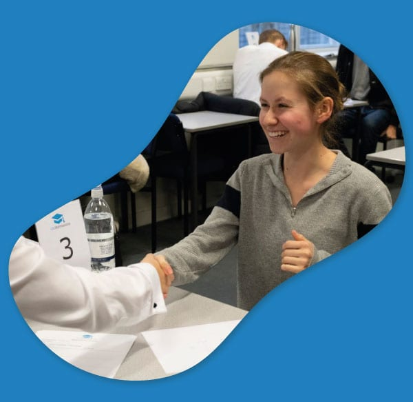 happy student shaking hands